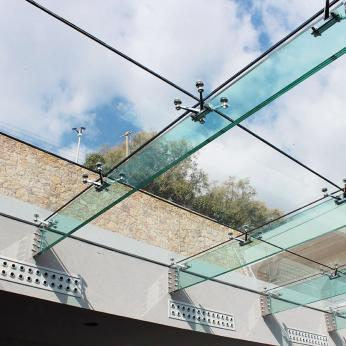Pool Skylight with Suspended Structural Glass Beams Glasscon.jpg